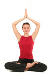 Woman practicing yoga. Woman sitting in lotus position Stock Images