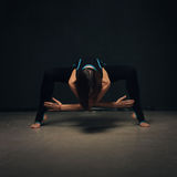 Woman practicing yoga Royalty Free Stock Image