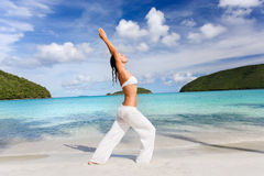Woman practicing yoga on beach Royalty Free Stock Photography