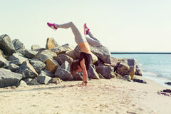 Woman practicing yoga at the beach Royalty Free Stock Photography