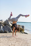 Woman practicing yoga at the beach Royalty Free Stock Photos