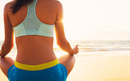 Woman Practicing Yoga on the Beach at Sunset Royalty Free Stock Photo