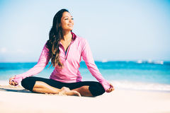 Woman practicing yoga on the beach royalty free stock photo