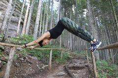 Woman practicing yoga on bridge. The picture was taken in wood near Black Lake on Zabljak municipium. The model was certificated Yoga instructor Milica Perovic Stock Photos