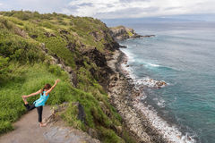 Woman Practicing Yoga on the Coast Stock Photo