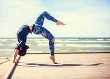 Woman practicing yoga Royalty Free Stock Image