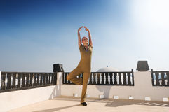 Woman practicing yoga dancing Stock Photos
