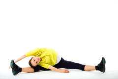 Woman practicing yoga, doing splits exercise. Royalty Free Stock Photography