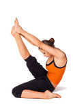 Woman Practicing Yoga Heron Pose Stock Photography