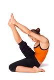 Woman Practicing Yoga Heron Pose Stock Photography