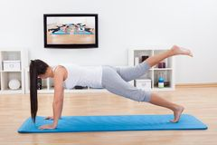 Woman practicing yoga at home Royalty Free Stock Photo