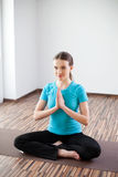 Woman practicing yoga at home Royalty Free Stock Image