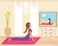 Woman practicing yoga indoors. Young woman practicing yoga indoors Stock Photos