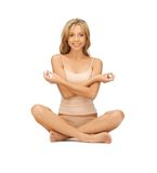 Woman practicing yoga lotus pose Stock Images