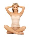 Woman practicing yoga lotus pose Stock Photos