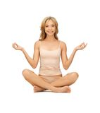 Woman practicing yoga lotus pose Royalty Free Stock Photography