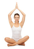 Woman practicing yoga lotus pose stock photo
