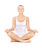 Woman practicing yoga lotus pose Royalty Free Stock Photo