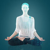 Woman practicing yoga in the lotus position Royalty Free Stock Image