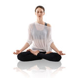 Woman practicing yoga in the lotus position Stock Images