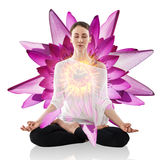 Woman practicing yoga in the lotus position Stock Image