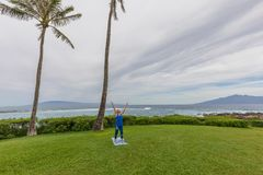 Woman Practicing Yoga on Maui. A woman practicing yoga along the scenic coast of Maui Hawaii Royalty Free Stock Photography