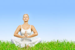 woman practicing yoga meditating outdoors Stock Images