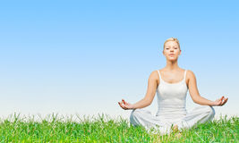 Woman practicing yoga meditating outdoors Royalty Free Stock Photography