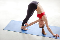 Woman practicing yoga and meditation on the floor stock images