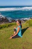 Woman Practicing Yoga Meditation on Maui. A woman practicing yoga along the scenic coast of Maui Hawaii Royalty Free Stock Photography