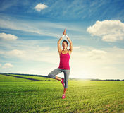 Woman practicing yoga at outdoor Royalty Free Stock Photos