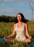 Woman practicing yoga outdoors Royalty Free Stock Photography