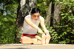 Woman practicing yoga outdoors Royalty Free Stock Images