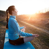 woman practicing yoga outside Stock Images