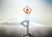 Woman practicing yoga over wooden boards Stock Images
