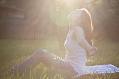 Woman practicing yoga at the park Stock Images