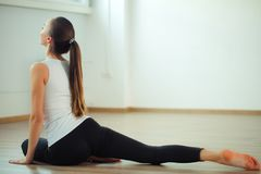 Woman practicing yoga pose at yoga healthy sport gym royalty free stock image