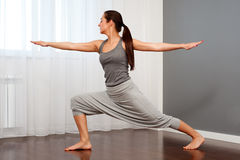 Woman practicing yoga in room Royalty Free Stock Images