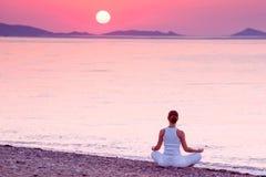 Woman practicing yoga at seashore Royalty Free Stock Photography