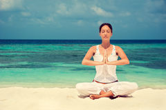 Woman practicing yoga at seashore Stock Images