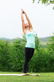 Woman is practicing yoga Side Moon Crescent Stock Image