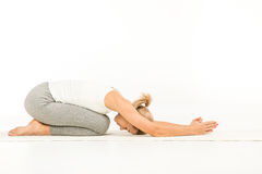 Woman practicing yoga Stock Image
