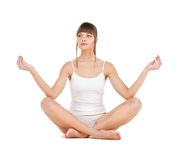 Woman practicing yoga Stock Photos