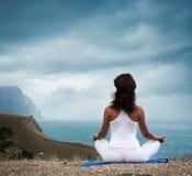Woman Practicing Yoga at Stormy Sea Royalty Free Stock Photos