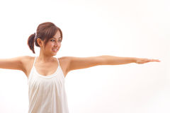 Woman practicing yoga stretching warrior pose Royalty Free Stock Image