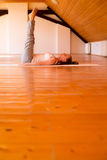 Woman practicing Yoga in a Studio Royalty Free Stock Photography