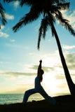 Woman practicing  Yoga at Sunset Stock Photo