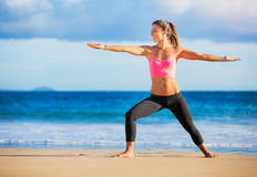 Woman practicing yoga at sunset Royalty Free Stock Images