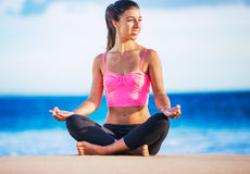 Woman practicing yoga at sunset Royalty Free Stock Image