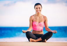 Woman practicing yoga at sunset Stock Images